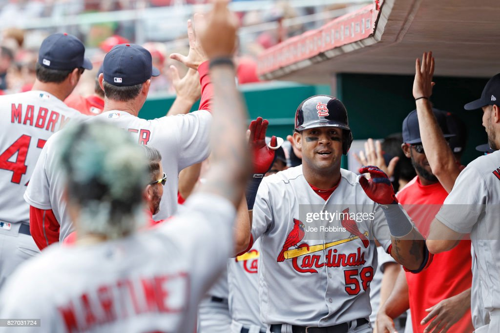 Jose Martinez #58 of the St. Louis Cardinals celebrates with teammates in the dugout after hitting a grand slam home run in the fourth inning of a game against the Cincinnati Reds at Great American Ball Park on August 6, 2017 in Cincinnati, Ohio.