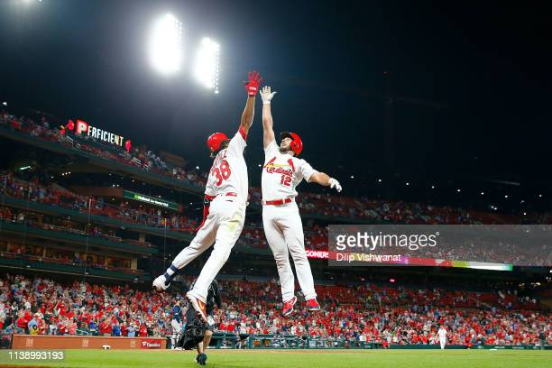 Jose Martinez of the St Louis Cardinals congratulates Paul DeJong of the St Louis Cardinals after DeJong hits a home run against the Milwaukee...