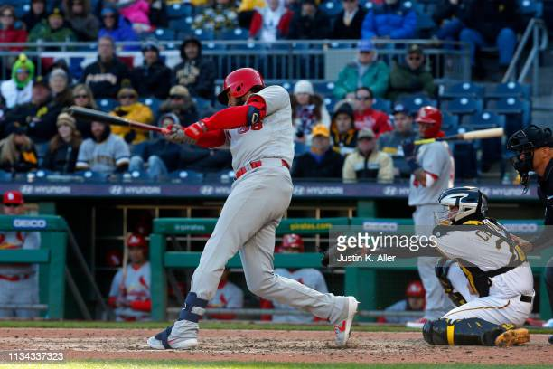 Jose Martinez of the St. Louis Cardinals hits a RBI double in the ninth inning against the Pittsburgh Pirates at the home opener at PNC Park on April...