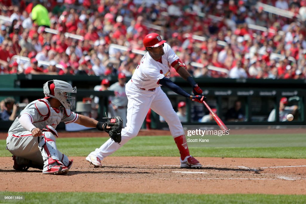 Jose Martinez #38 of the St. Louis Cardinals hits a RBI single during the seventh inning against the Philadelphia Phillies at Busch Stadium on May 20, 2018 in St. Louis, Missouri.
