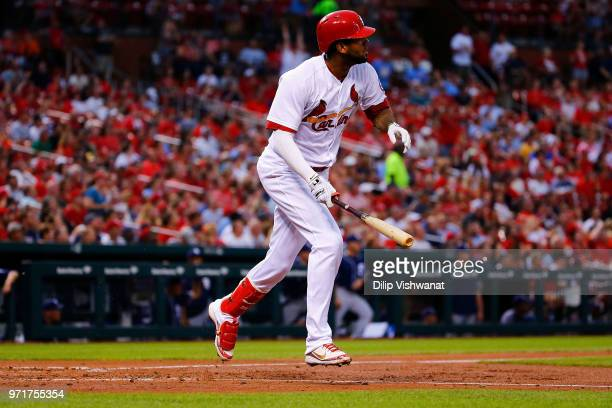 Jose Martinez of the St Louis Cardinals hits a tworun home run against the San Diego Padres in the third inning at Busch Stadium on June 11 2018 in...