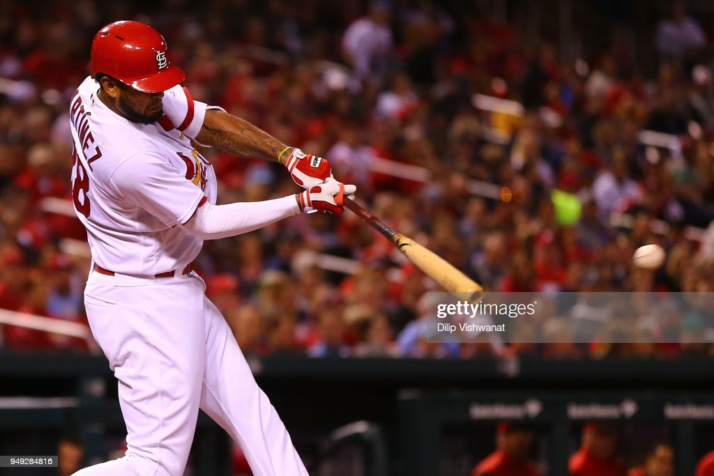 Jose Martinez #38 of the St. Louis Cardinals hits an RBI double against the Cincinnati Reds in the second inning at Busch Stadium on April 20, 2018 in St. Louis, Missouri.