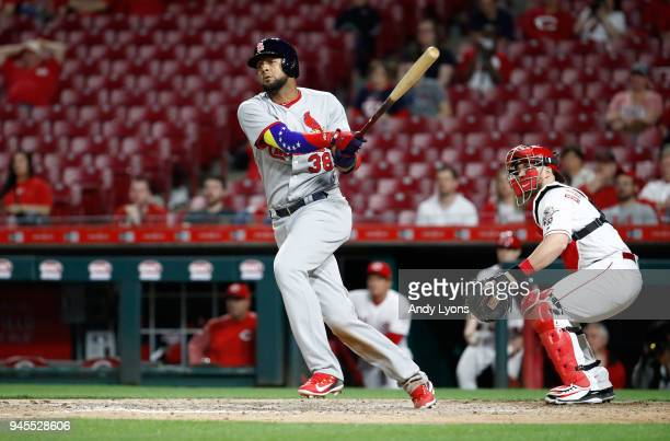 Jose Martinez of the St Louis Cardinals hits an RBI double in the ninth inning against the Cincinnati Reds at Great American Ball Park on April 12...