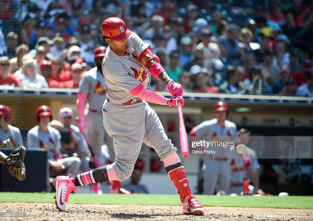 Jose Martinez #38 of the St. Louis Cardinals hits an RBI single during the sixth inning of a baseball game against the San Diego Padres at PETCO Park on May 13, 2018 in San Diego.