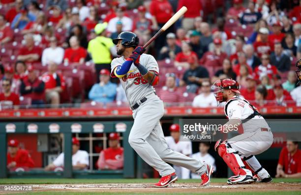 Jose Martinez of the St Louis Cardinals hits an RBI single in the first inning against the Cincinnati Reds at Great American Ball Park on April 12...