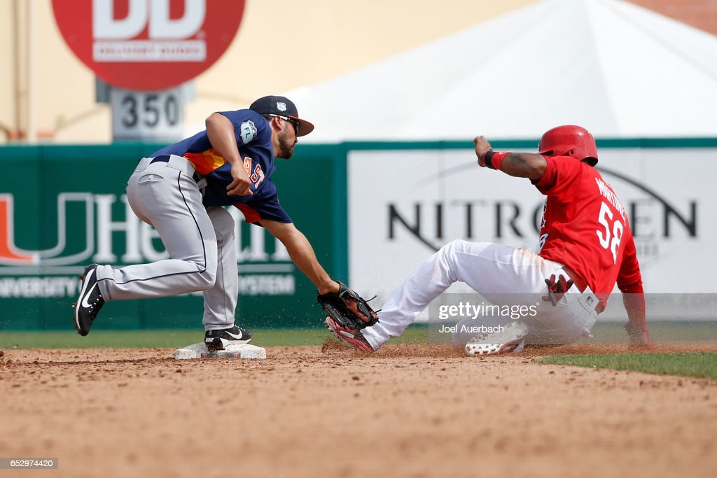 Jose Martinez #58 of the St Louis Cardinals is caught stealing by Jack Mayfield #83 of the Houston Astros to end the sixth inning during a spring training game at Roger Dean Stadium on March 13, 2017 in Jupiter, Florida. The Cardinals defeated the Astros 6-3.
