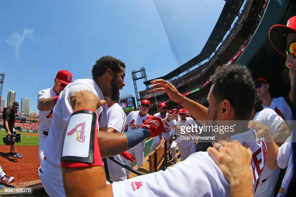 Jose Martinez of the St Louis Cardinals is congratulated by teammates after hitting a home run against the Minnesota Twins in the first inning at...