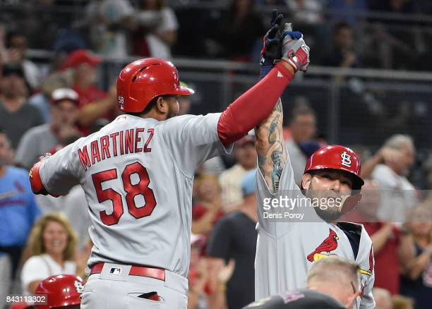 Jose Martinez of the St Louis Cardinals is congratulated by Yadier Molina after hitting a tworun home run during the first inning of a baseball game...