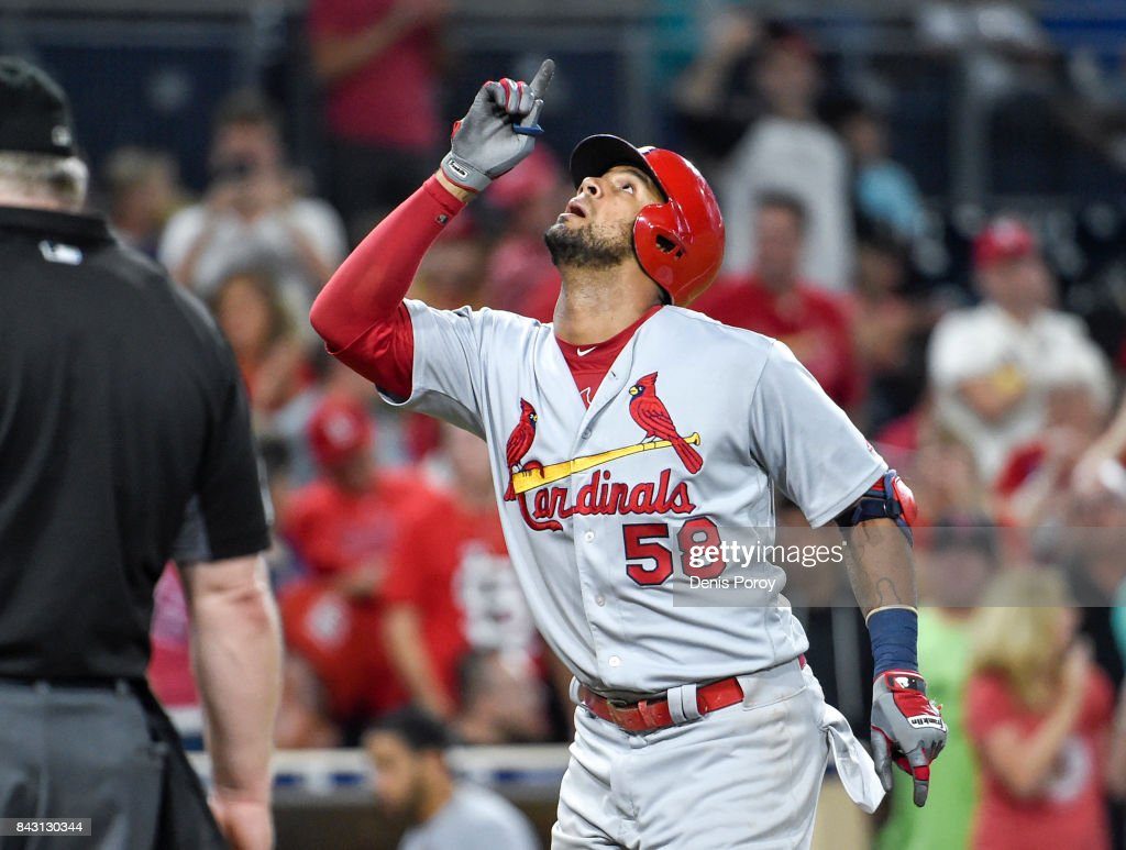Jose Martinez #58 of the St. Louis Cardinals points skyward after hitting a solo home run during the seventh inning of a baseball game against the San Diego Padres at PETCO Park on September 5, 2017 in San Diego, California.