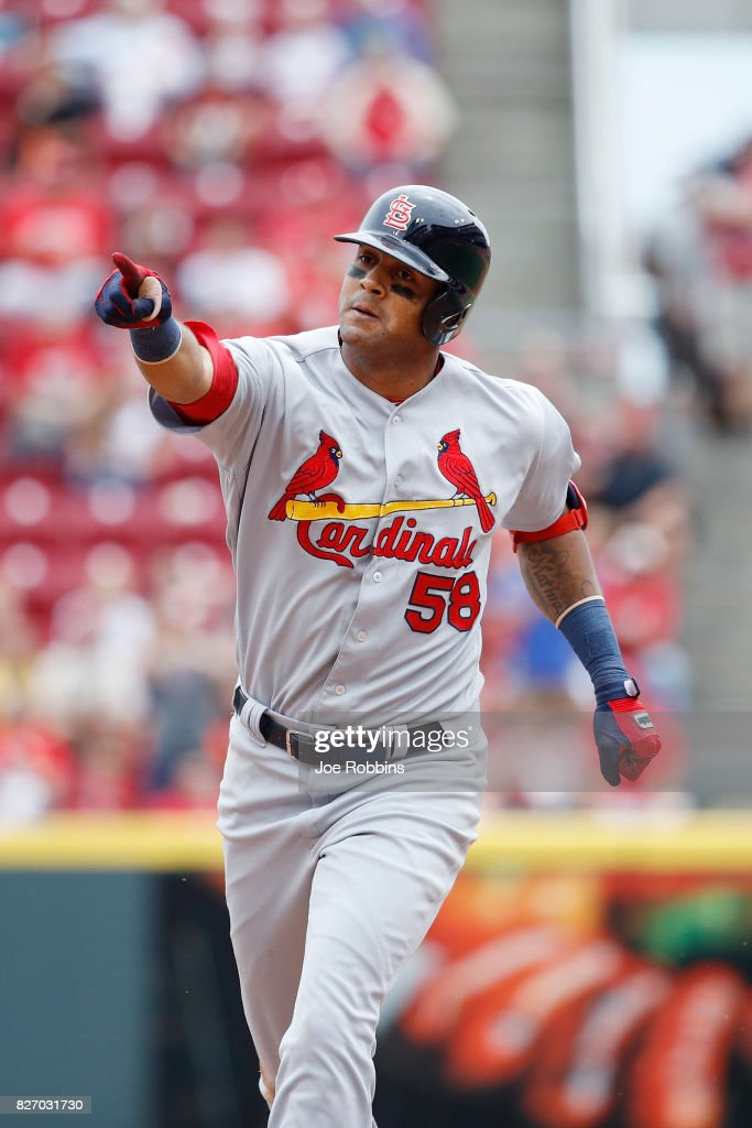Jose Martinez #58 of the St. Louis Cardinals reacts as he rounds the bases after hitting a grand slam home run in the fourth inning of a game against the Cincinnati Reds at Great American Ball Park on August 6, 2017 in Cincinnati, Ohio.