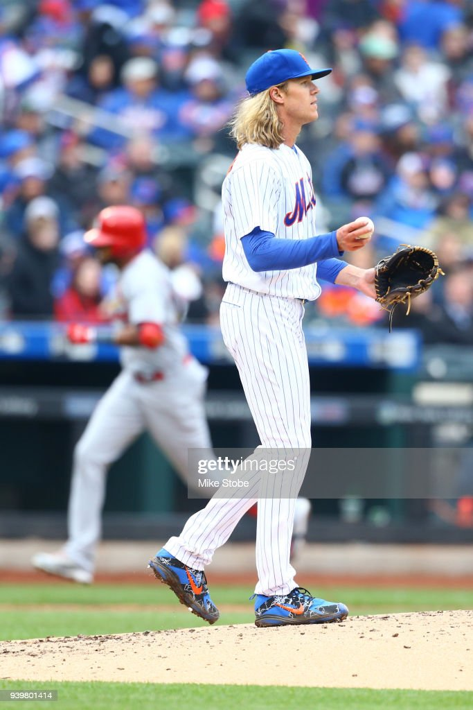 Jose Martinez #38 of the St. Louis Cardinals rounds third base after hitting a solo home run in the sixth inning as Noah Syndergaard #34 of the New York Mets reacts on Opening Day at Citi Field on March 29, 2018 in the Flushing neighborhood of the Queens borough of New York City.