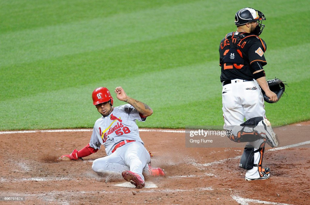 Jose Martinez #58 of the St. Louis Cardinals scores in the sixth inning against the Baltimore Orioles at Oriole Park at Camden Yards on June 16, 2017 in Baltimore, Maryland. St. Louis won the game 11-2.