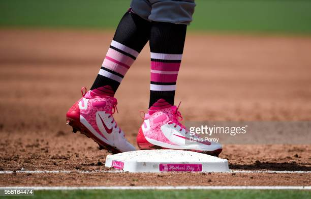 Jose Martinez of the St Louis Cardinals stands on a Mother's Day first base during the third inning of a baseball game against the San Diego Padres...