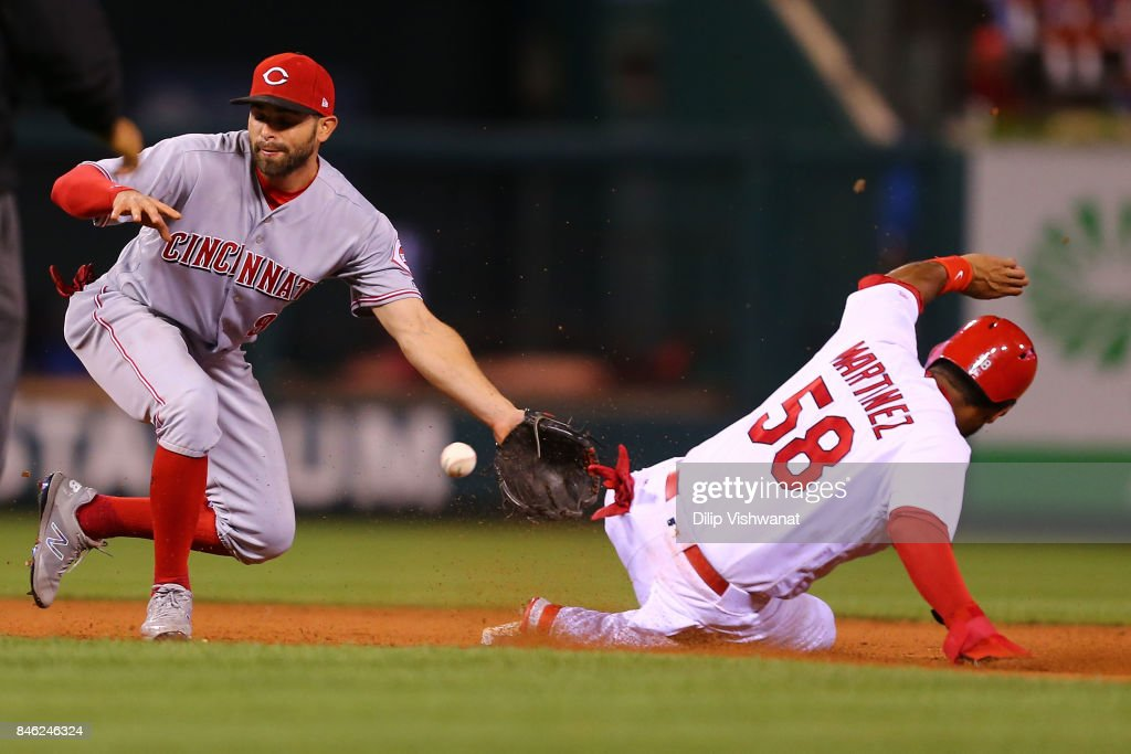 Jose Martinez #58 of the St. Louis Cardinals steals second base against Zack Cozart #2 of the Cincinnati Reds in the sixth inning at Busch Stadium on September 12, 2017 in St. Louis, Missouri.