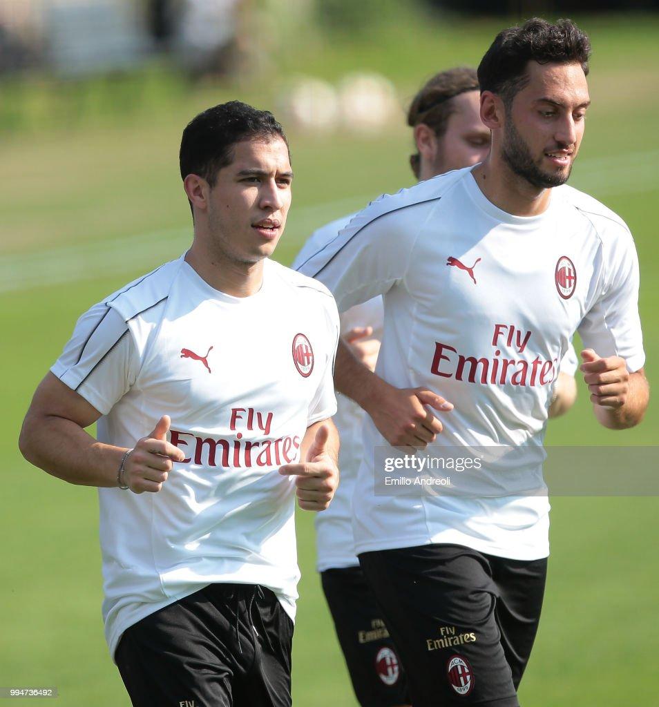 Jose Mauri of AC Milan trains with his teammate Hakan Calhanoglu ...