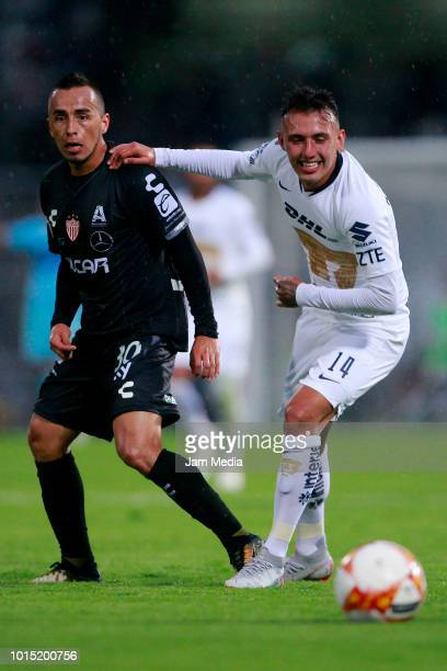 Jose Medina of Necaxa fights for the ball with Brian Figueroa of Pumas during the match between Pumas UNAM and Necaxa as part of the Copa MX Apertura...
