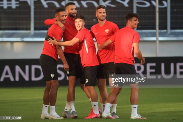 Jose Mena and Sergi Gomez huddle with team mates during an Sevilla FC Training Session And Press Conference at MSV Arena on August 05 2020 in...