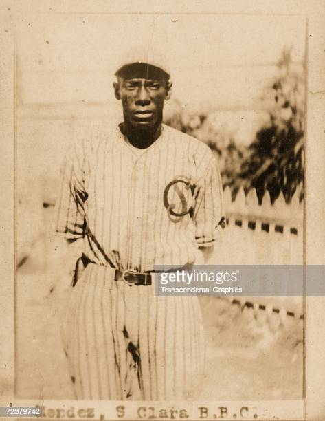 Jose Mendez pitcher for the Santa Clara Leopards poses outside the ballpark for a portrait on this Billiken cigarette card from 1923