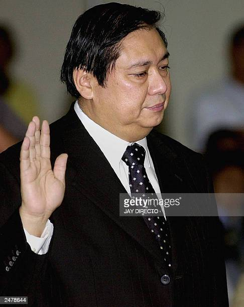 Jose Miguel Arroyo the husband of Philippine President Gloria Arroyo is sworn in at a Senate hearing over opposition allegations that he was involved...