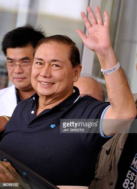 Jose Miguel Arroyo waves after being discharged from Manila's St Lukes Medical Center accompanied by his wife Philippine President Gloria Arroyo on...