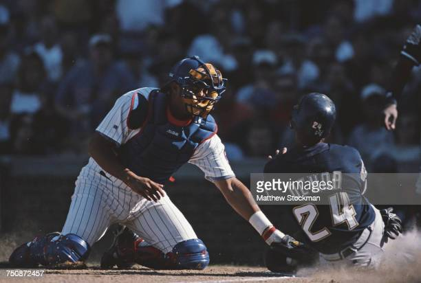 Jose Molina catcher for the Chicago Cubs tags Alex Ochoa infielder for the Milwaukee Brewers as he slides into home plate during their Major League...