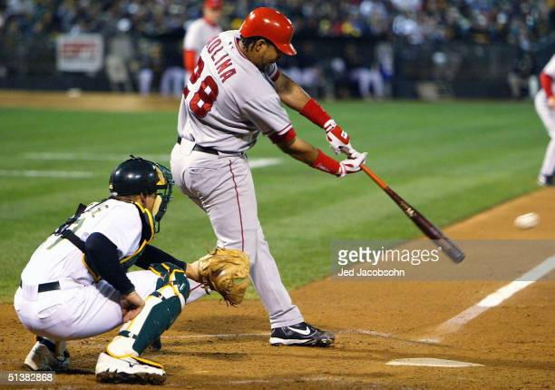 Jose Molina of the Anaheim Angels hits an RBI single in the second inning against the Oakland Athletics on October 1 2004 at the Network Associates...