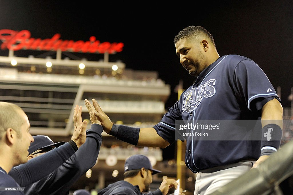 Jose Molina #28 of the Tampa Bay Rays celebrates scoring a run against the Minnesota Twins during the seventh inning of the game on September 13, 2013 at Target Field in Minneapolis, Minnesota.