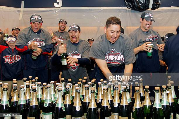 Jose Morales Scott Baker Brian Fuentes and Carl Pavano of the Minnesota Twins celebrate clinching the American League Central Division Title after...