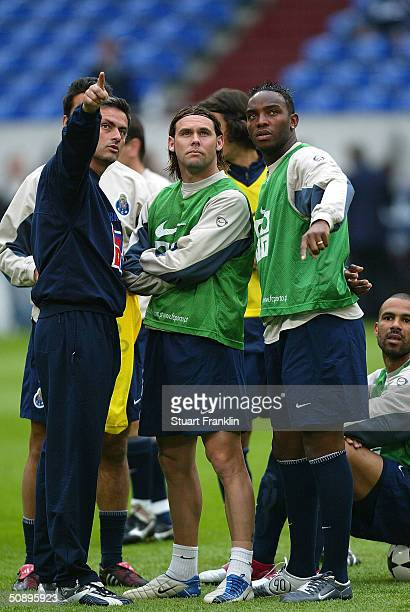 Jose Mourinho Coach of FC Porto makes a point to Jose Bosingwa and Benedict McCarthy during training before The UEFA Champions League Final at The...