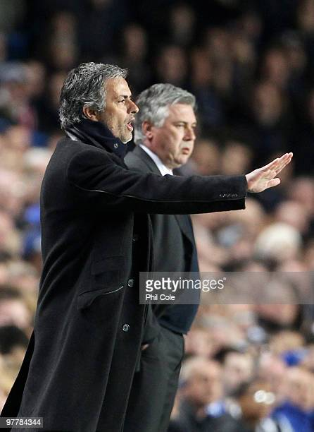 Jose Mourinho Coach of Inter Milan gives instructions as Carlo Ancelotti Manager of Chelsea looks on during the UEFA Champions League Round of 16...