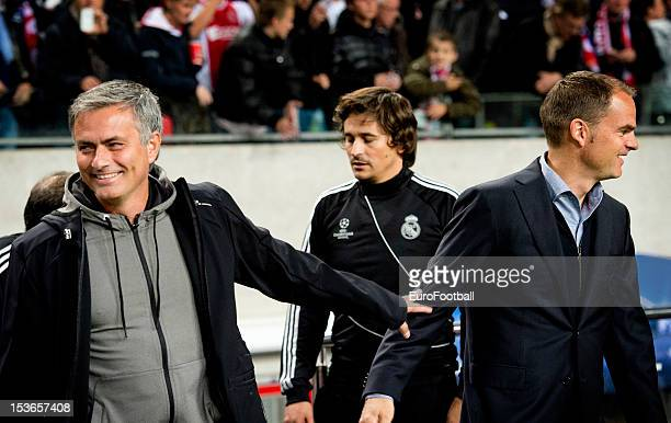 Jose Mourinho coach of Real Madrid CF greets Frank de Boer coach of AFC Ajax prior to the UEFA Champions League group stage match between AFC Ajax...