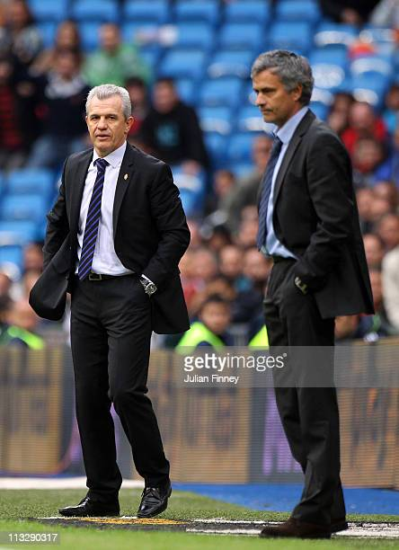 Jose Mourinho coach of Real Madrid looks on at full time with Real Zaragoza coach Javier Aguirre after the La Liga match between Real Madrid and Real...