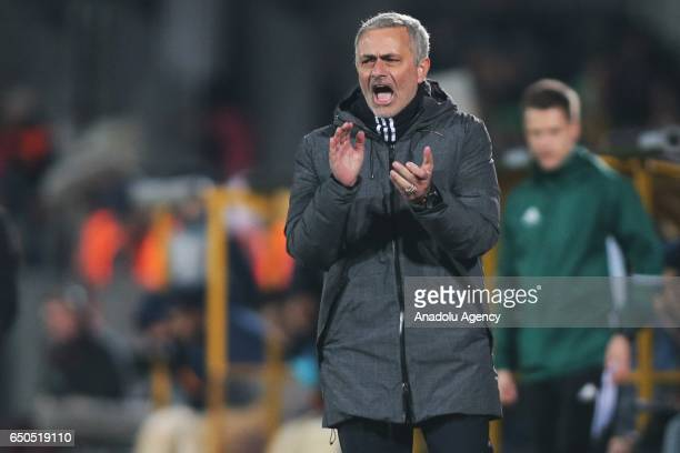 Jose Mourinho Head coach of Manchester United gestures as he watches the UEFA Europa League Round of 16 first leg match between FC Rostov and...