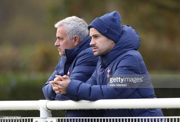 Jose Mourinho Head Coach of Tottenham Hotspur and assistant Joao Sacramento watch the action during the PL2 match between Tottenham Hotspur and Derby...
