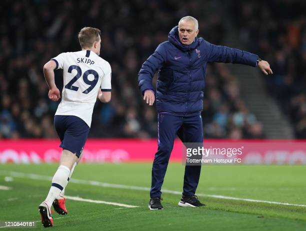 Jose Mourinho Head Coach of Tottenham Hotspur and Oliver Skipp during the FA Cup Fifth Round match between Tottenham Hotspur and Norwich City at...