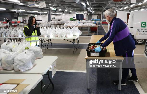 Jose Mourinho Head Coach of Tottenham Hotspur delivers food produce from the Training Center to the Tottenham Hotspur Stadium food hub to aid the...