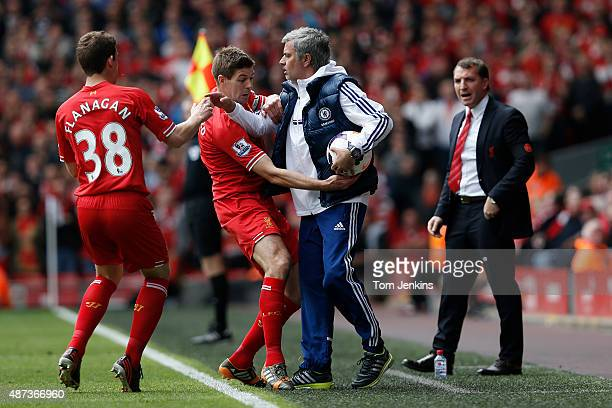 Jose Mourinho keeps the ball despite the efforts of Steven Gerrard during the Liverpool versus Chelsea Barclays FA Premier League match at Anfield on...