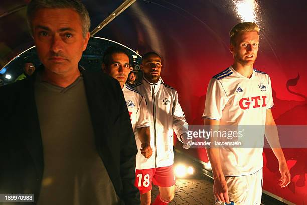 Jose Mourinho looks on with Andre Schuerrle after the Michael Ballack farewell match at Red Bull Arena on June 5 2013 in Leipzig Germany