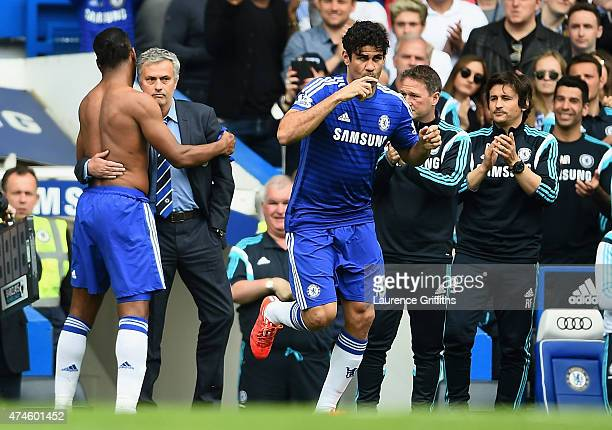 Jose Mourinho manager of Chelsea and Didier Drogba of Chelsea hug as he is replaced to Diego Costa during the Barclays Premier League match between...