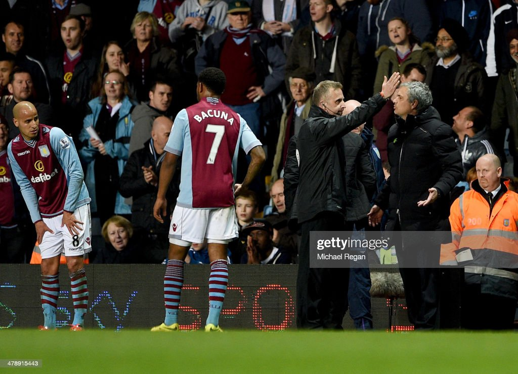 Jose Mourinho manager of Chelsea appeals to fourth official Jonathan Moss as he is sent off during the Barclays Premier League match between Aston Villa and Chelsea at Villa Park on March 15, 2014 in Birmingham, England.