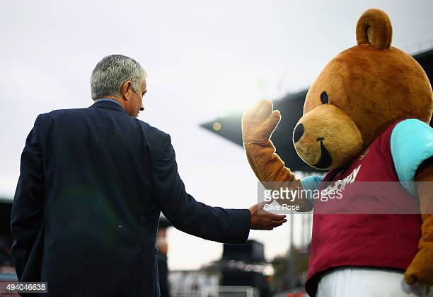 Jose Mourinho Manager of Chelsea high fives with West Ham United mascot Bubbles prior to the Barclays Premier League match between West Ham United...