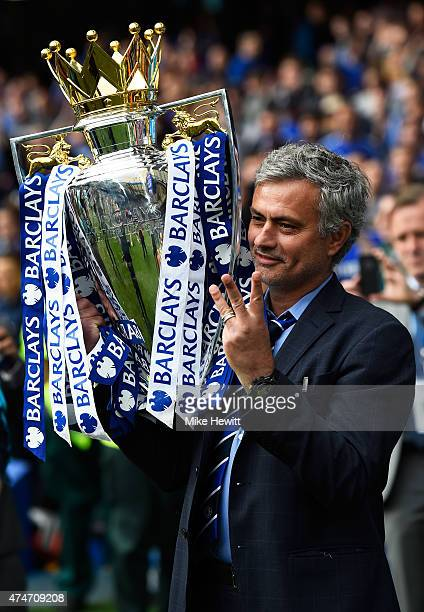 Jose Mourinho manager of Chelsea holds up three fingers as he celebrates with the trophy after the Barclays Premier League match between Chelsea and...