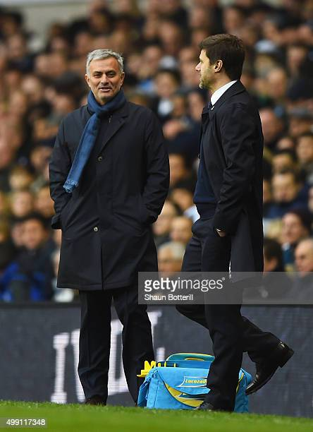 Jose Mourinho manager of Chelsea jokes with Mauricio Pochettino manager of Tottenham Hotspur during the Barclays Premier League match between...