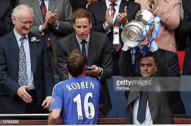 Jose Mourinho manager of Chelsea lifts the FA Cup trophy as HRH Prince William gives Arjen Robben his medal following the FA Cup Final match...