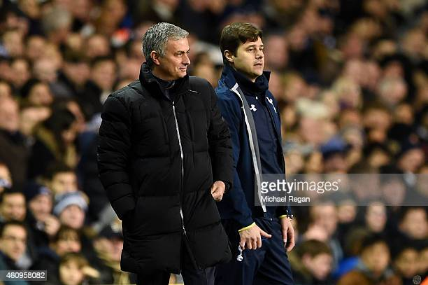 Jose Mourinho manager of Chelsea smiles as he stands next to Mauricio Pochettino manager of Spurs during the Barclays Premier League match between...
