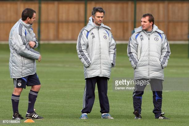 Jose Mourinho Manager of Chelsea speaks with his coaching staff Brendan Rodgers and Steve Clarke during training in CobhamEngland