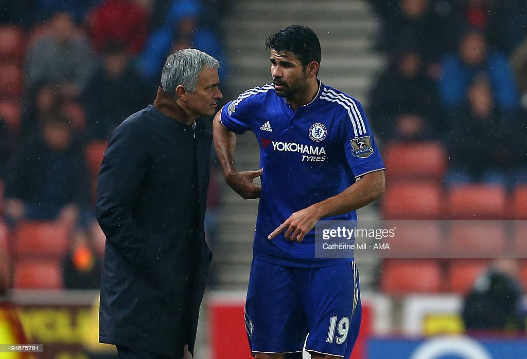 Jose Mourinho Manager of Chelsea talks to Diego Costa of Chelsea during the Capital One Cup Fourth Round match between Stoke City and Chelsea at Britannia Stadium on October 27, 2015 in Stoke on Trent, England.