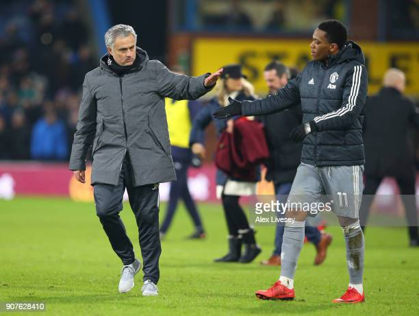 Jose Mourinho Manager of Manchester United and Anthony Martial of Manchester United celebrate victory after the Premier League match between Burnley...