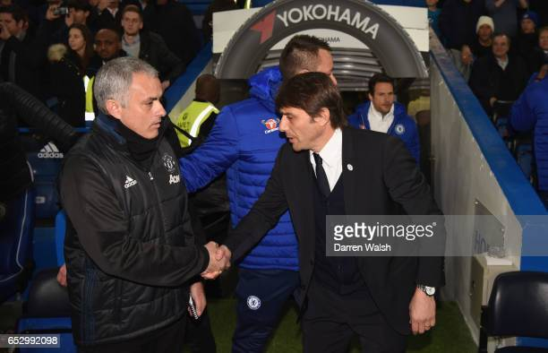 Jose Mourinho manager of Manchester United and Antonio Conte manager of Chelsea shake hands prior to The Emirates FA Cup QuarterFinal match between...