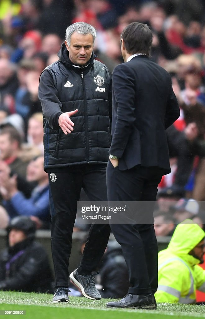 Jose Mourinho, Manager of Manchester United and Antonio Conte, Manager of Chelsea shake hands after the Premier League match between Manchester United and Chelsea at Old Trafford on April 16, 2017 in Manchester, England.
